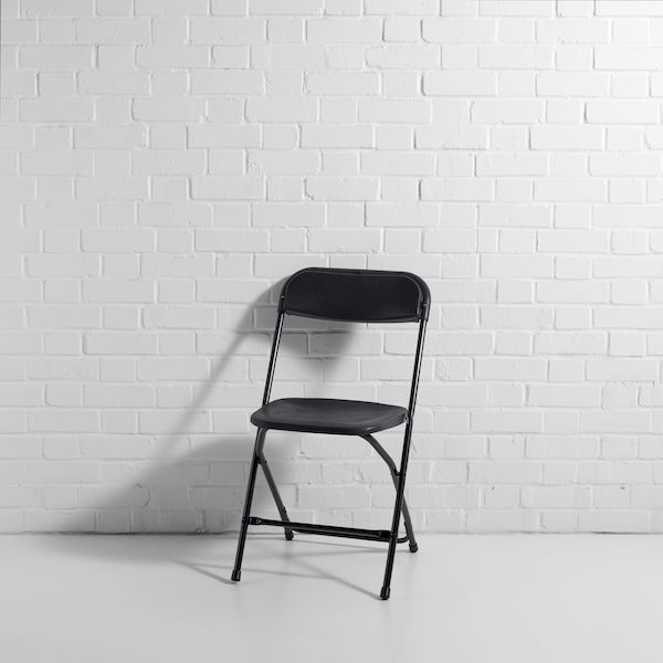 black folding chair side